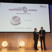Rosswag GmbH accepting the EPMA PM Component Award in the Additive Manufacturing Category from EPMA President Mr Philippe Gundermann